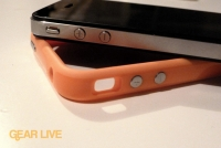 iPhone 4 resting on orange Bumper Case