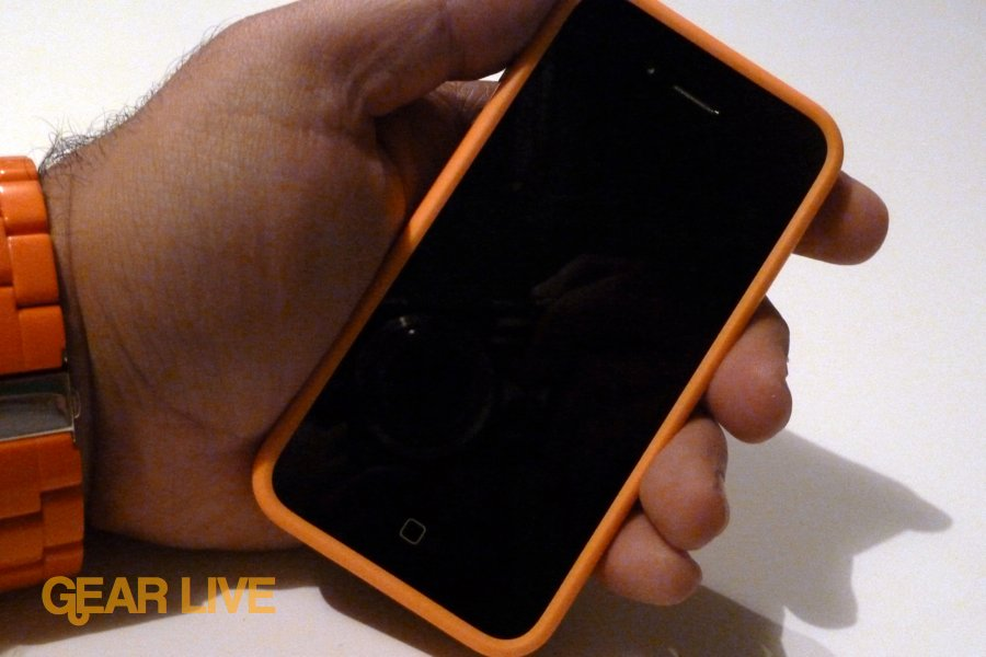 Holding iPhone 4 in orange bumper case
