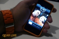 iPhone 4 in orange bumper powered on