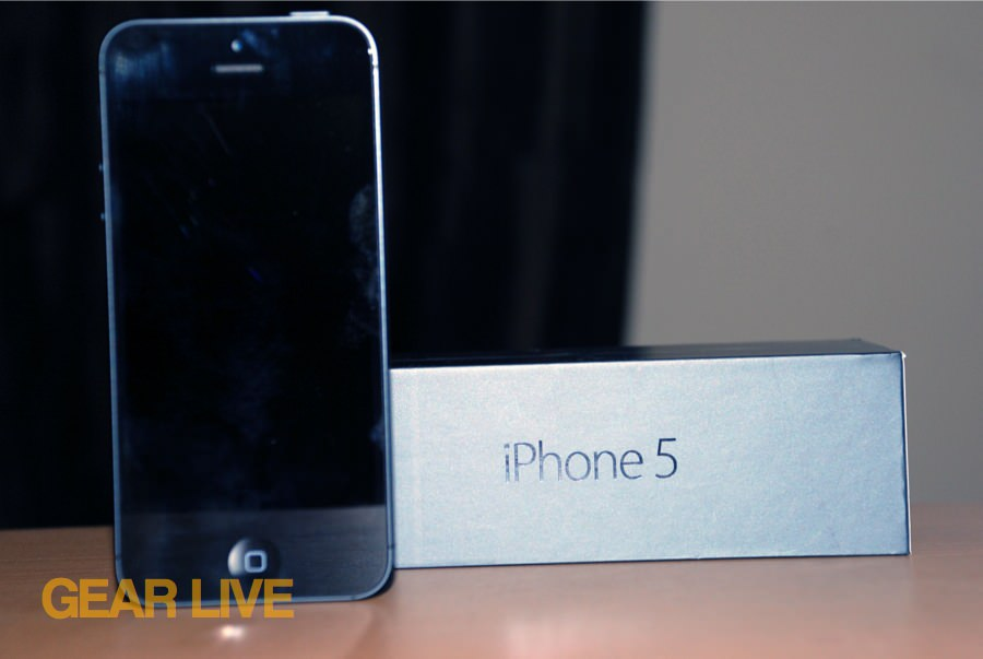 iPhone 5 black & slate standing next to box