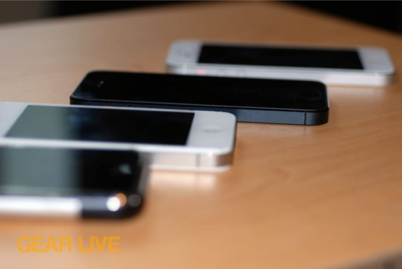 iPhone, iPhone 4S, iPhone 5 (white and black) next to each other