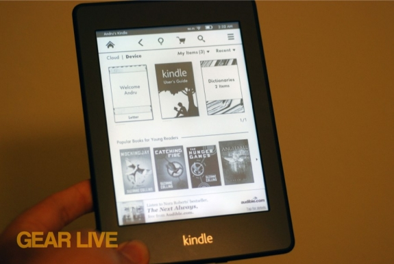Holding Kindle Paperwhite