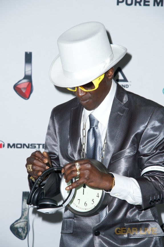Flava Flav signing Monster DNA White Tuxedo headphones