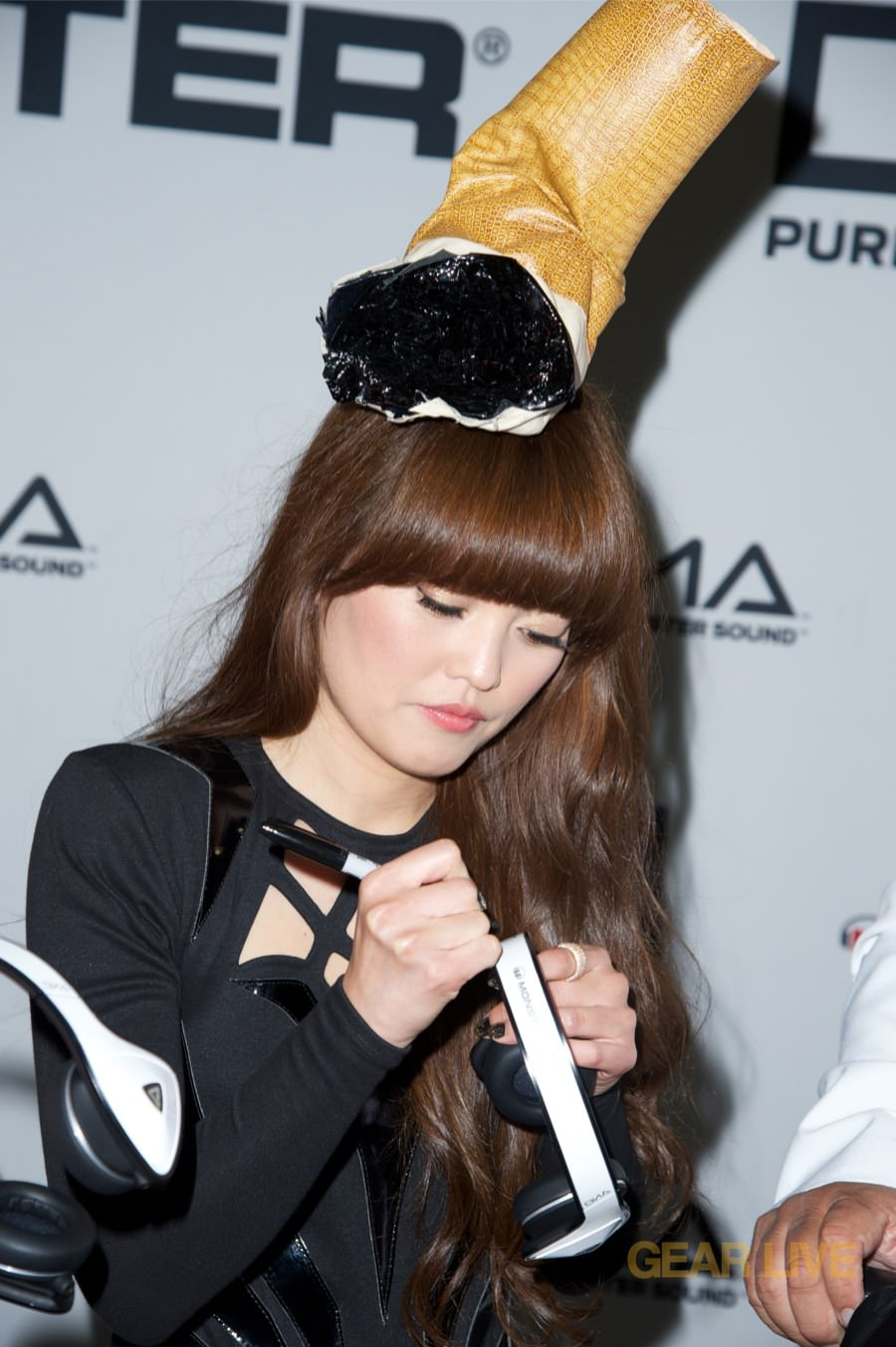 Hanna Mae Lee signs Monster DNA White Tuxedo headphones