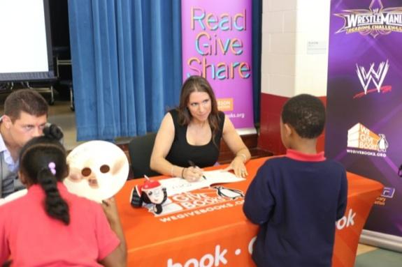 Stephanie McMahon autographs books