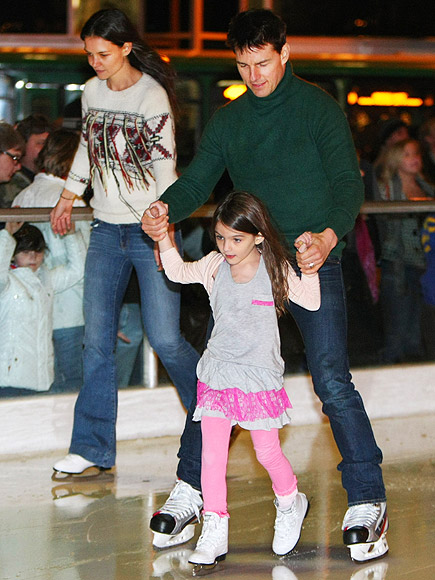 Katie Holmes and Tom Cruise with their daughter Suri