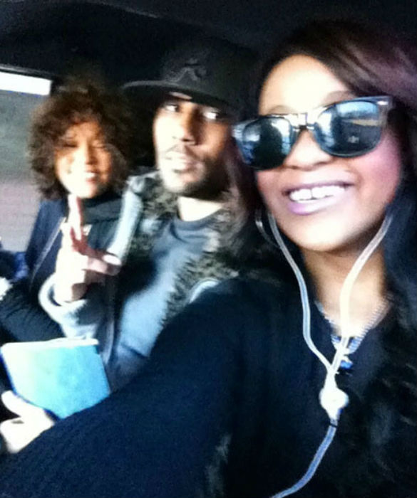 Whitney Houston with her son Nick and daughter Bobbi Kristina