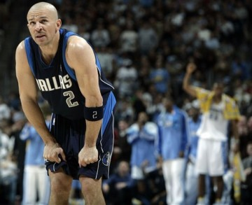 Jason Kidd tugging on shorts