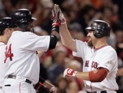 Youkilis is greeted by David Ortiz at home plate