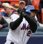 Carlos Delgado hits a solo home run in the 7th inning