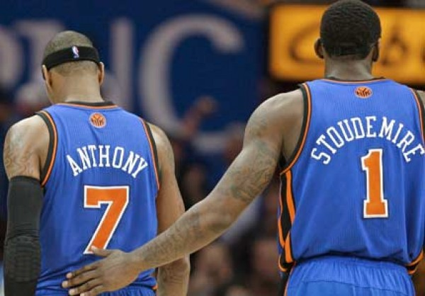 Carmelo Anthony and Amar'e Stoudemire walking away in disappointment