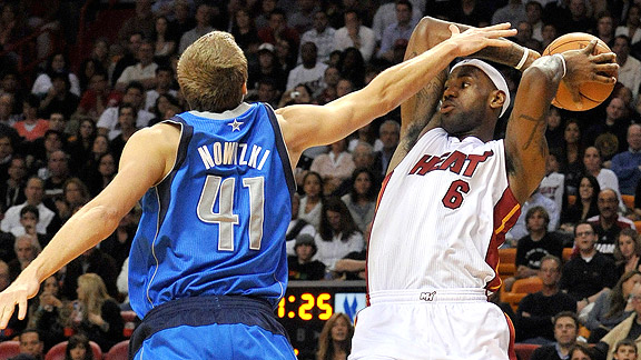 Dirk Nowitzki tries to stop a LeBron James' shot