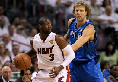 Dwyane Wade and Dirk Nowitzki do battle for the NBA title