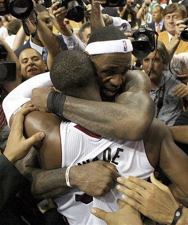 Dwyane Wade and LeBron James celebrate the Miami Heat moving forward