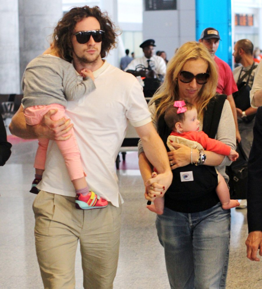 Aaron and Sam Taylor-Johnson with their kids