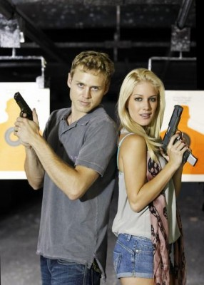 Spencer Pratt and Heidi Montag holding guns