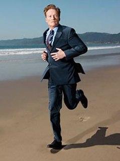 Conan O'Brien running on beach