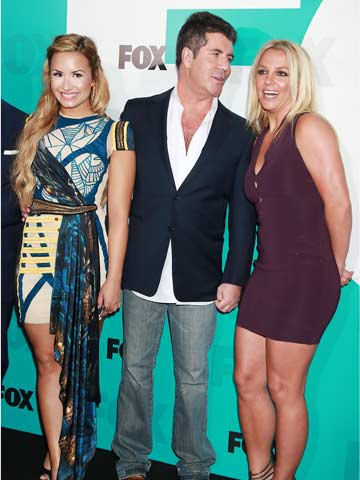 Demi Lovato with Simon Cowell and Britney Spears
